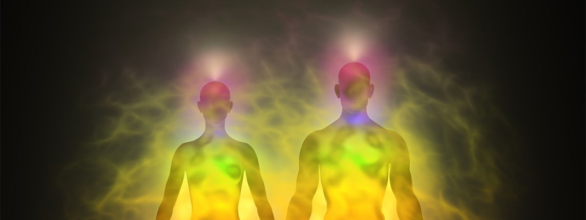 Two people with chakra auras